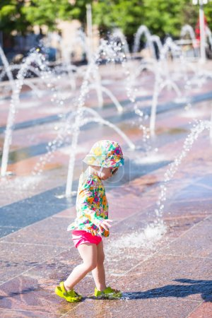 Toddler playing with fountains