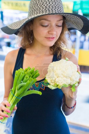 woman at local Farmers Market