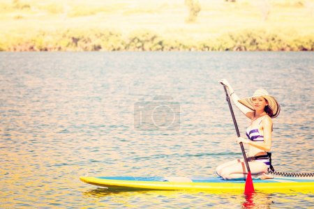 Young woman Paddleboarding