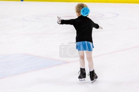 Girl practicing figure skating