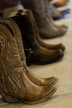 Cowboy boots of wedding party
