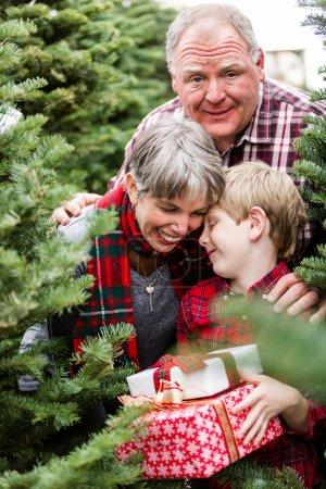 Family at Christmas tree farm