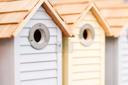 Row of wooden birdhouses