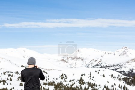 Man take pictures at Loveland pass