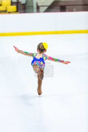 Cute girl practicing ice skating