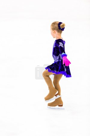 Young figure skater practicing
