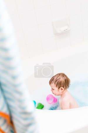 Baby girl having a bath
