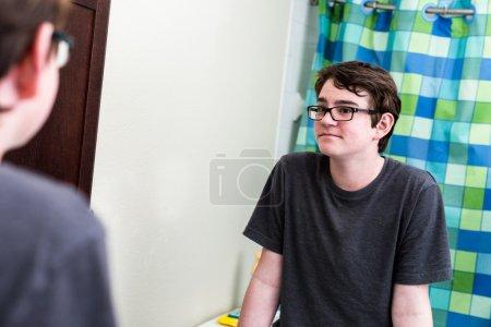 Teenage boy getting ready for school