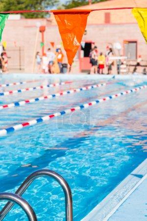 Kids swim meet in outdoor pool
