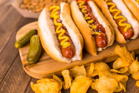 Grilled hot dogs with mustard and ketchup