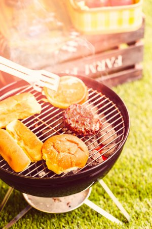 Summer picnic with small charcoal grill