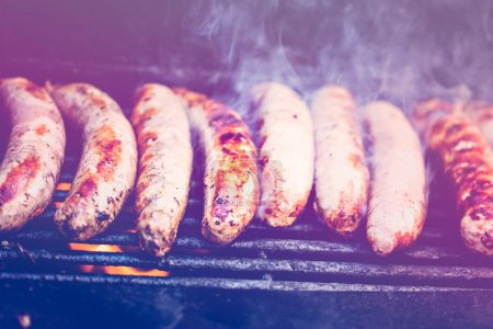 Cooking meat on barbecue grill
