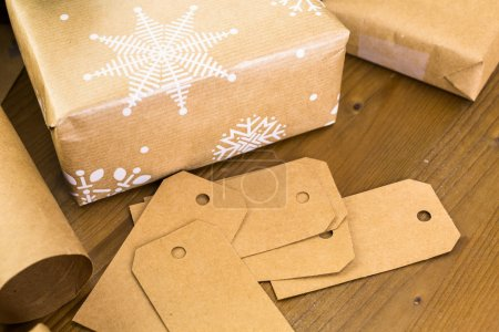 Christmas gifts wrapped in brown paper