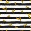 Seamless repeat pattern with gold foil leaves on b...