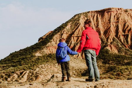 father and son travel in scenic mountains