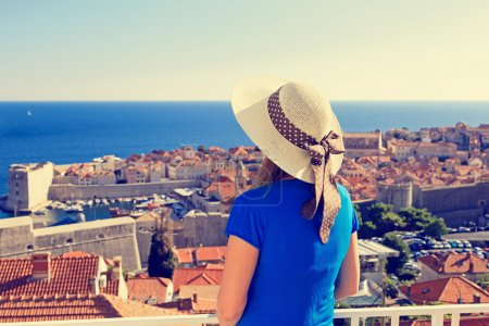 young woman looking at Dubrovnik, Croatia