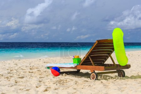 kids toys on tropical vacation