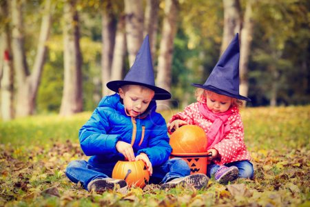 Photo for Kids in halloween costume play at autumn park, kids trick or treating - Royalty Free Image
