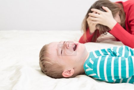 Photo for Child is crying whild mother is tired, difficult parenting - Royalty Free Image