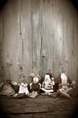 Photo for Christmas card background with a space for text on a wooden surface and old rag dolls Santa Christmas - Royalty Free Image