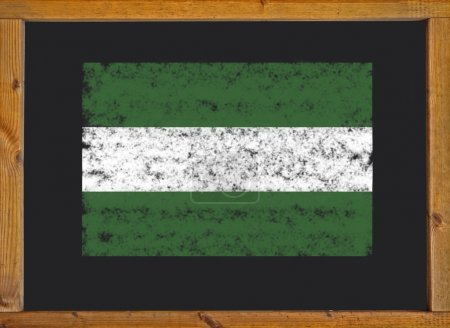 The flag of the autonomous community of Andalusia on a blackboard