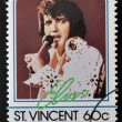 Постер, плакат: ST VINCENT CIRCA 1985: A stamp printed in St Vincent shows Elvis Presley circa 1985