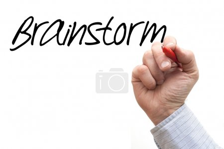A Photo Illustration of a Hand Writing 'Brainstorm...