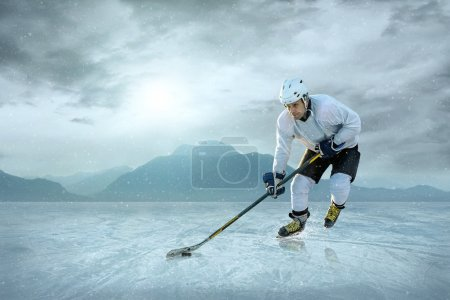Photo for Ice hockey player on the ice - Royalty Free Image