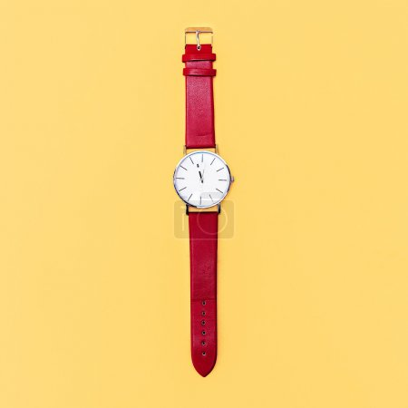 Red clock on yellow background. Minimalism design