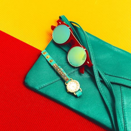 Stylish accessories. Green Leather Clutch, watches and sunglasse