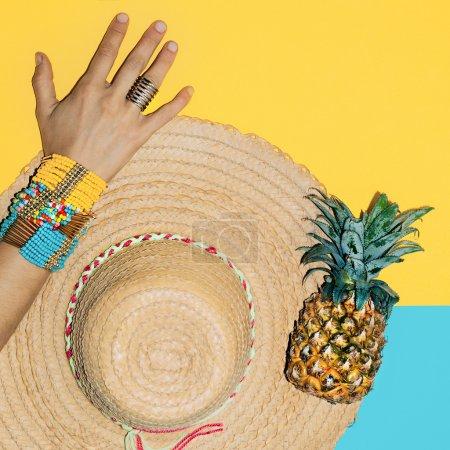 Bright stylish bracelets and straw hat. Time beach holiday. Summ