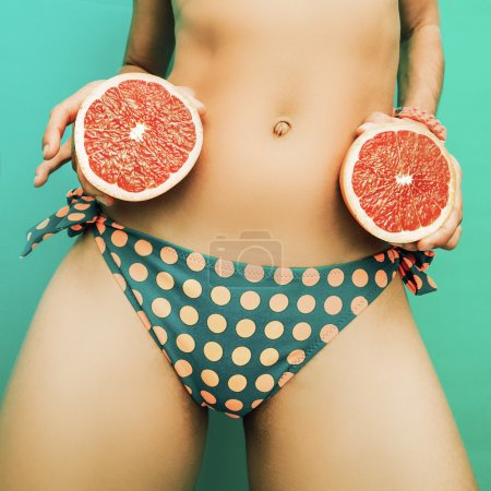 Sexy Girl with grapefruit. Citrus Party fashion