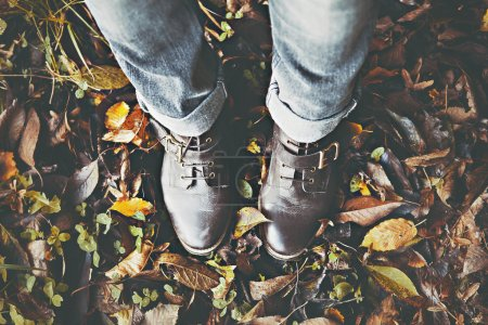 Vintage boots on fall foliage
