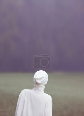Fashion photo. Glamour girl in a white dress in the woods. Ease