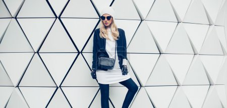 Glamorous blonde on the street. urban fashion