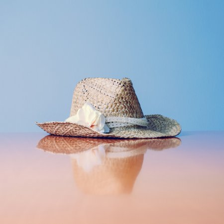Still Life of Sunhat with Flower Accent