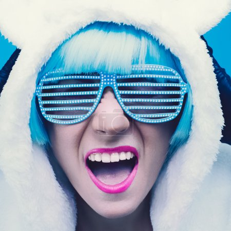 Photo for Positive girl on bright blue background. winter Style - Royalty Free Image
