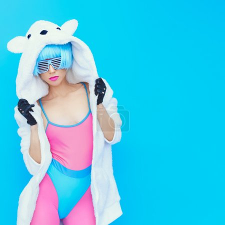 Photo for Teddy bear girl on a blue background. Crazy winter party. Club dance style - Royalty Free Image