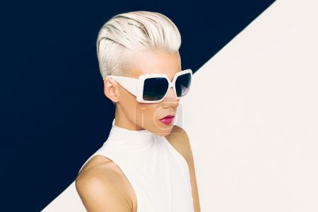 Photo for Blonde model in trendy sunglasses with stylish Haircut. Fashion photo - Royalty Free Image