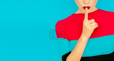 Secret girl on blue background. Red lips trend...