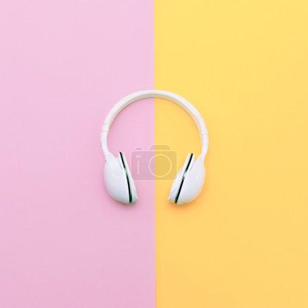Fashion white headphones on vanilla background. Urban summer tim