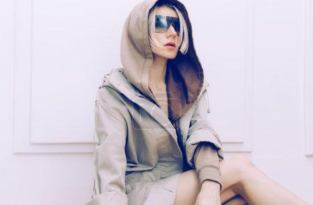 Sensual model in trendy denim coat. Spring fashion accessories.