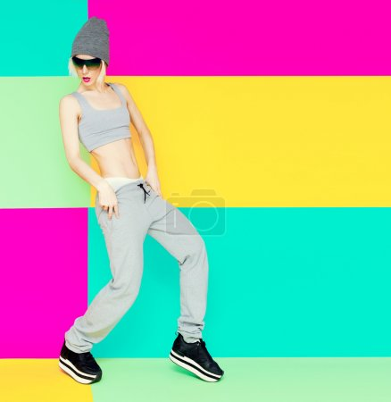 girl dancer on bright background. Lifestyle, Sports clothes, fas
