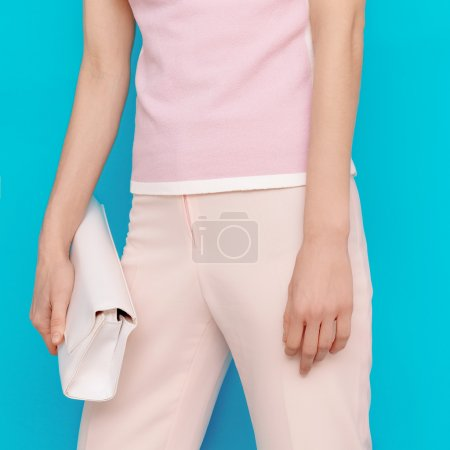 Fashion lady in summer clothes with stylish accessories. Light t