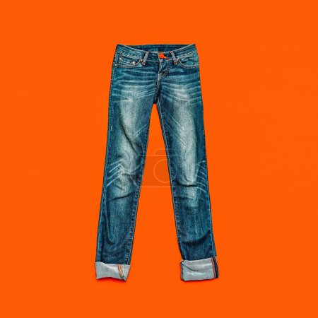 Blue jeans on bright orange background