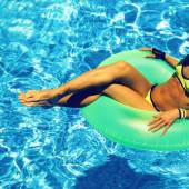 Glamour girl with inflatable circle in pool party Summer Style