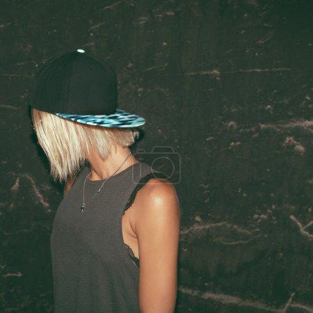 Photo for Stylish model in fashionable cap. Urban fashion style - Royalty Free Image