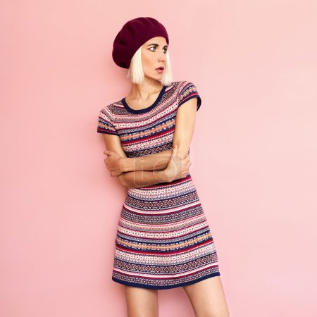 Romantic French style. Stylish girl in a beret and dress burgund