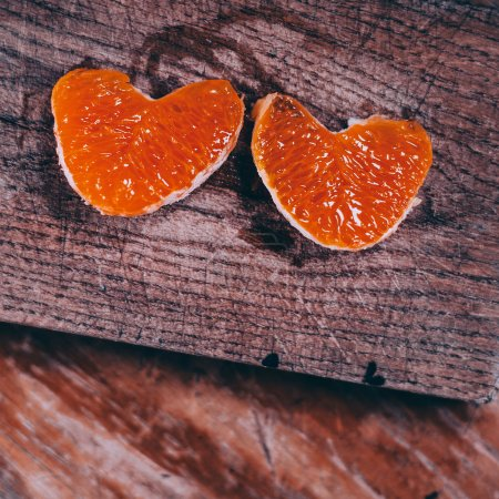 Minimal design. Mandarins on a wooden background