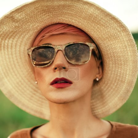 Romantic Lady outdoors in vintage hat